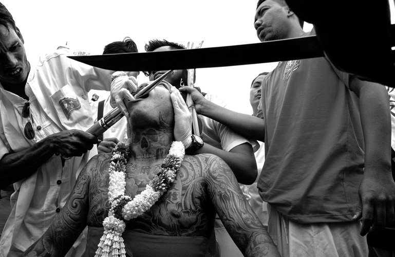 Every year during the Vegetarian Festival in Phuket, Thailand, acts of self-mortification are done  in honor of the gods and to display one's devotion to their beliefs.  The ritual happens every year from October 8th to the 17th.