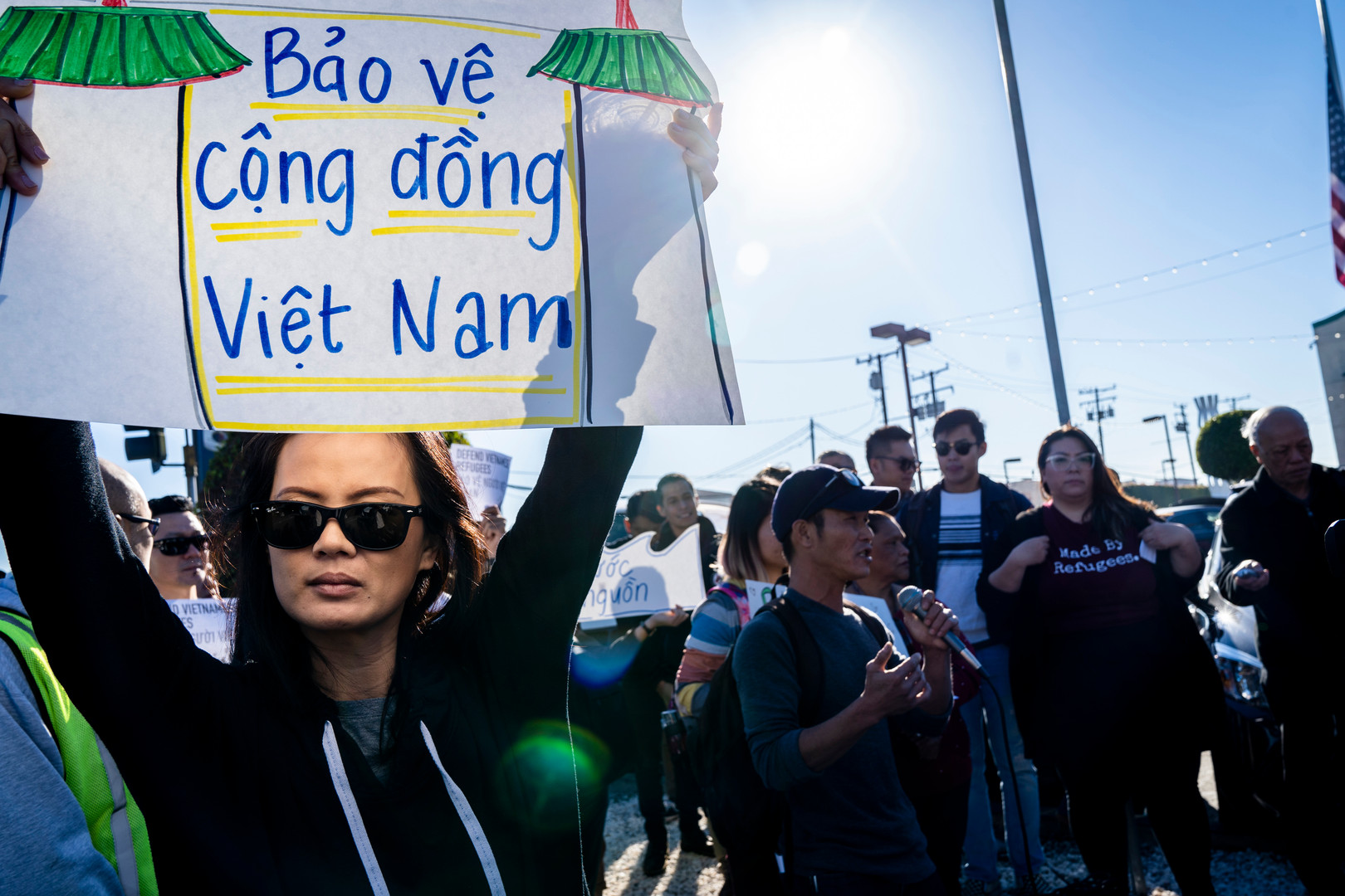 Thuy Vo Dang, 39, protests in Westminister, California against the Trump administration's possible re-interpretation of a 2008 agreement protecting Vietnamese immigrants arriving before 1995.