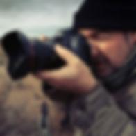 Man takin a photograph with a canon 5D digital camera