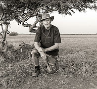 A black and white portrait of fine art landscape photographer Peter Corbett.