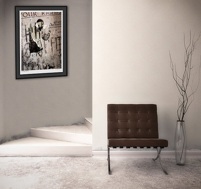 A framed print of nelson mandela displayed on a wall in a modern interior