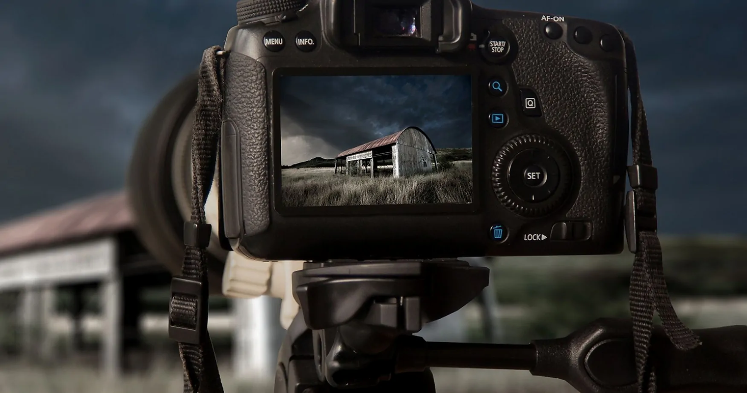 Back of a camera in live view taking a photograph of an old shed