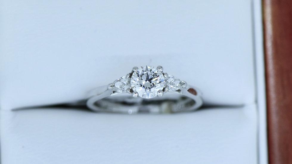 Three Stone ring pear shape diamond on side