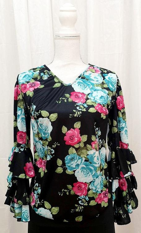 Blusa con flores turquesas y rosas