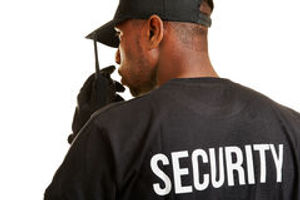 security-guard-talking-radio-set-behind-