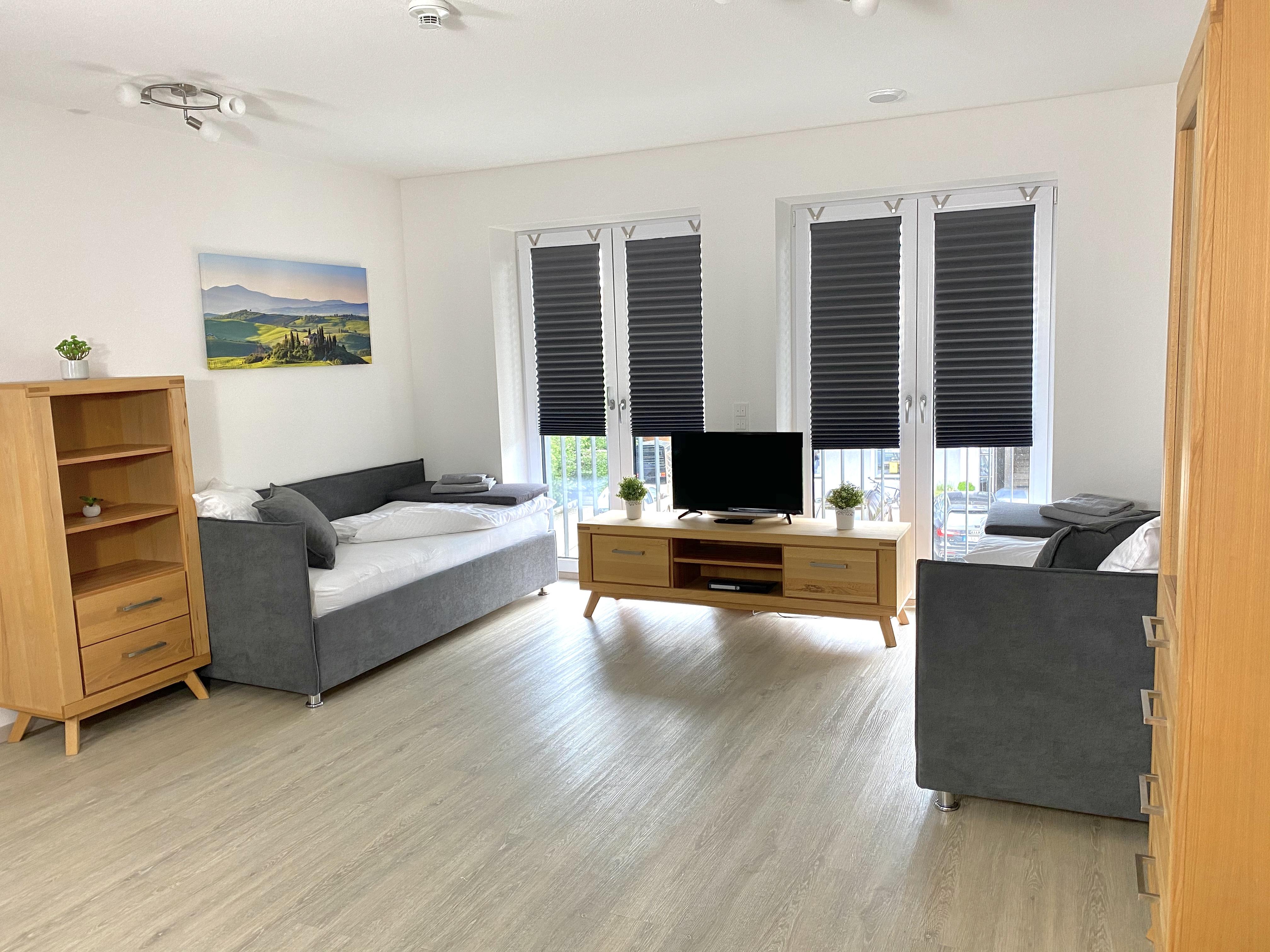 Wohn- & Schlafzimmer in der Unterkunft Poing