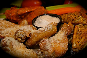 Hand-tossed chicken wings at Flip'n Chicken are coated in home-made sauces and savory spices.