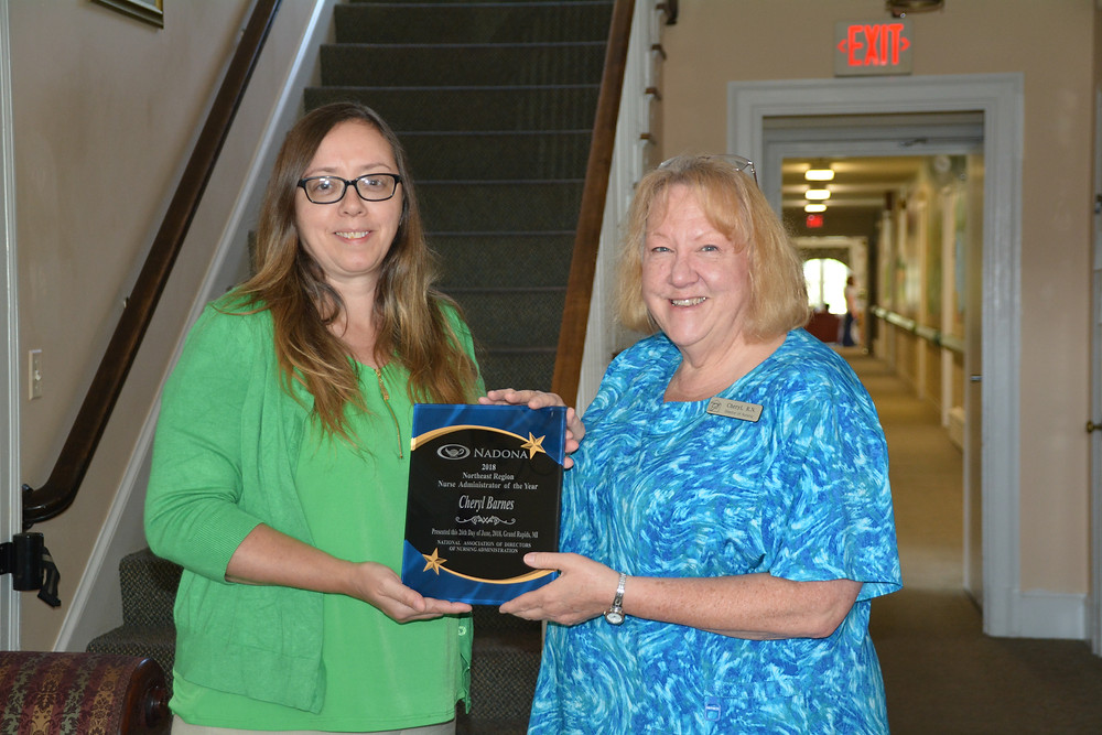Peabody Home's Director of Nurses, Cheryl Barnes (right) receiving her national award from the NADONA.