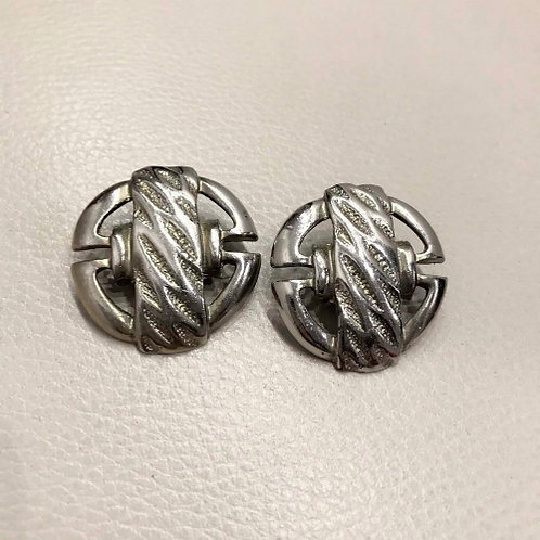 Vintage silvery clip on earrings in the shape of a round buckle