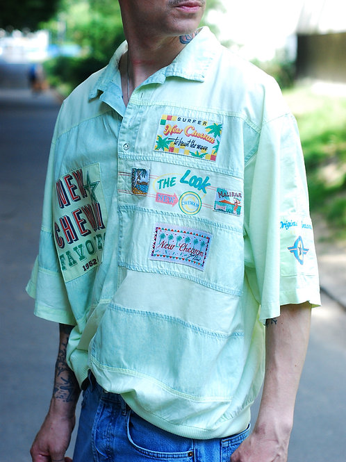 Vintage light green T-shirt with colorful badges