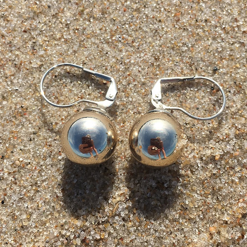 Vintage earrings with a dangling ball