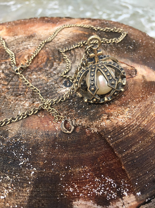 Vintage gold-ish pendant with hidden pearl