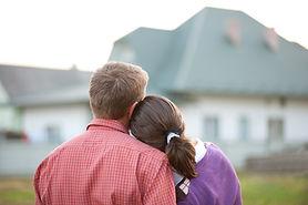 couple looking on house.jpg