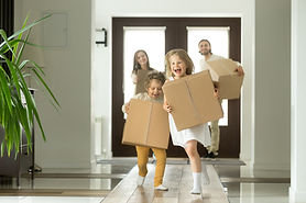 Happy family with kids bought new home, excited children funny girl and boy holding boxes