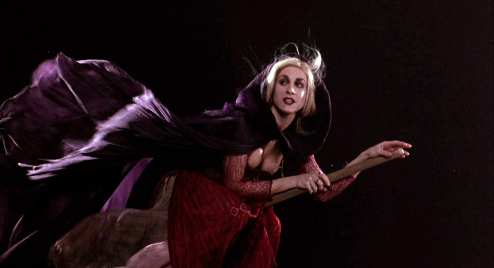 Sarah Jessica Parker flying on a broom stick in Hocus Pocus.