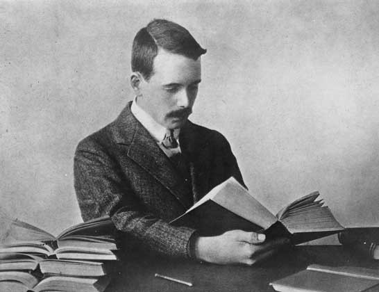 British Physicist Henry G.J. Moseley reading a book.