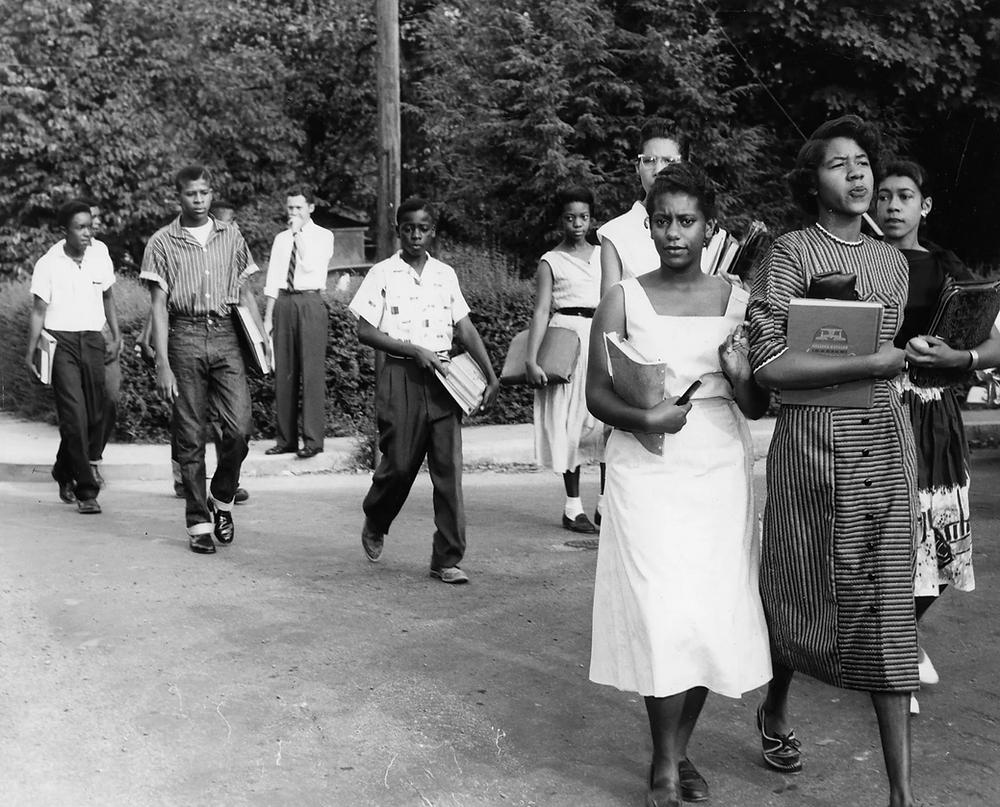 Clinton 12 walking to school. Jo Ann Allen Boyce on the right side.