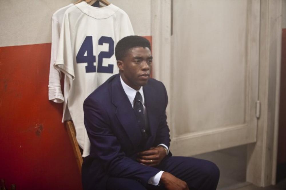 Chadwick Boseman as Jackie Robinson.
