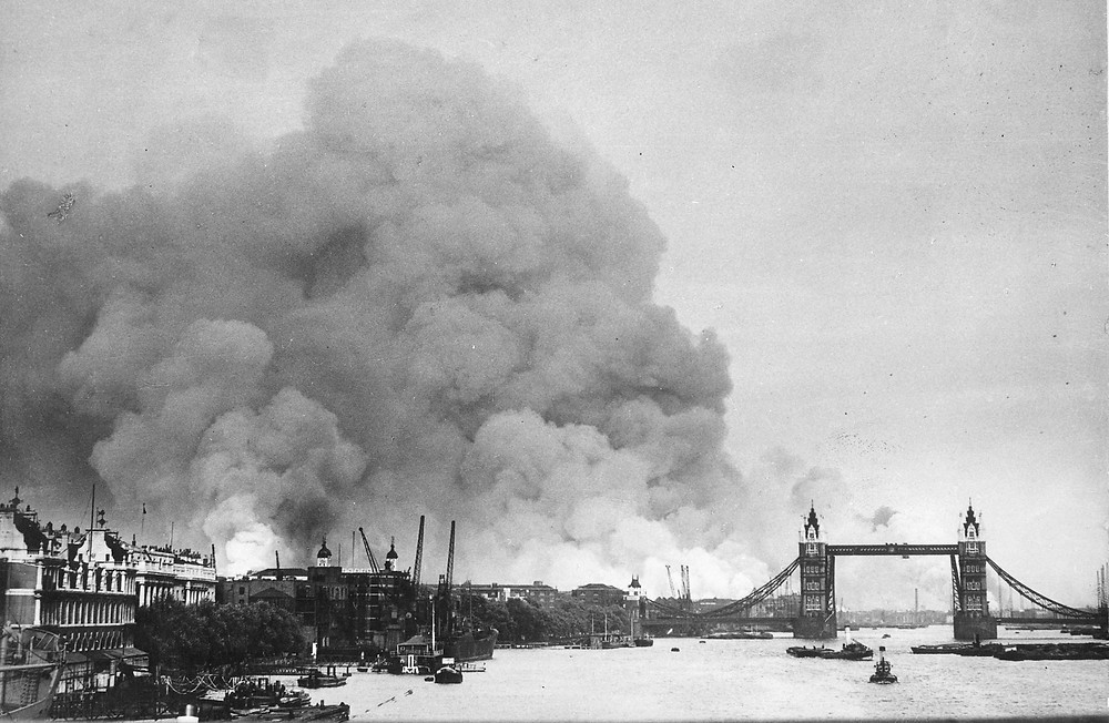 Fires burn during the Blitz of London in World War II.