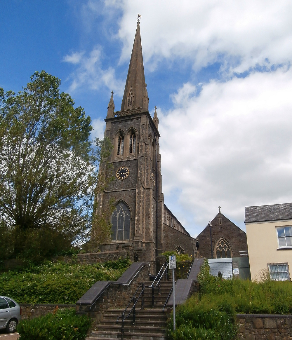 St. Elvan's Church, with a large spire on the front facade of the church.