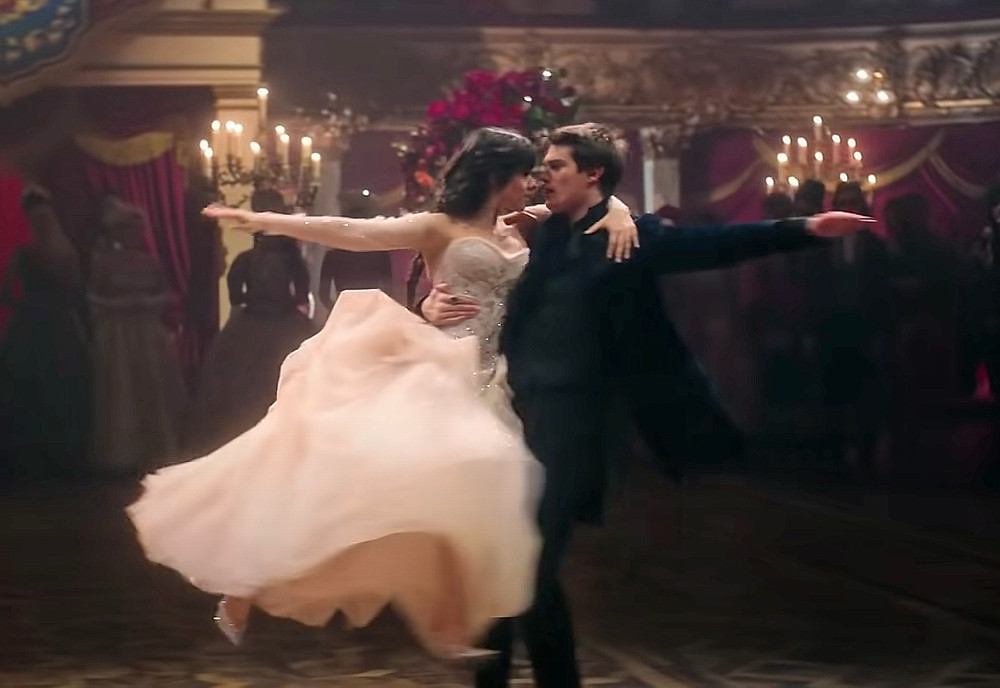 Nicholas Galitzine and Camila Cabello spin while ballroom dancing - Hollywood Ancestry by Mike Batie.