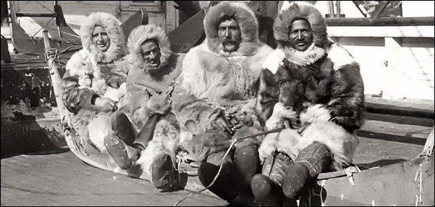 Matthew Henson (right) next to Robert Peary and other explorers on an Arctic expedition.
