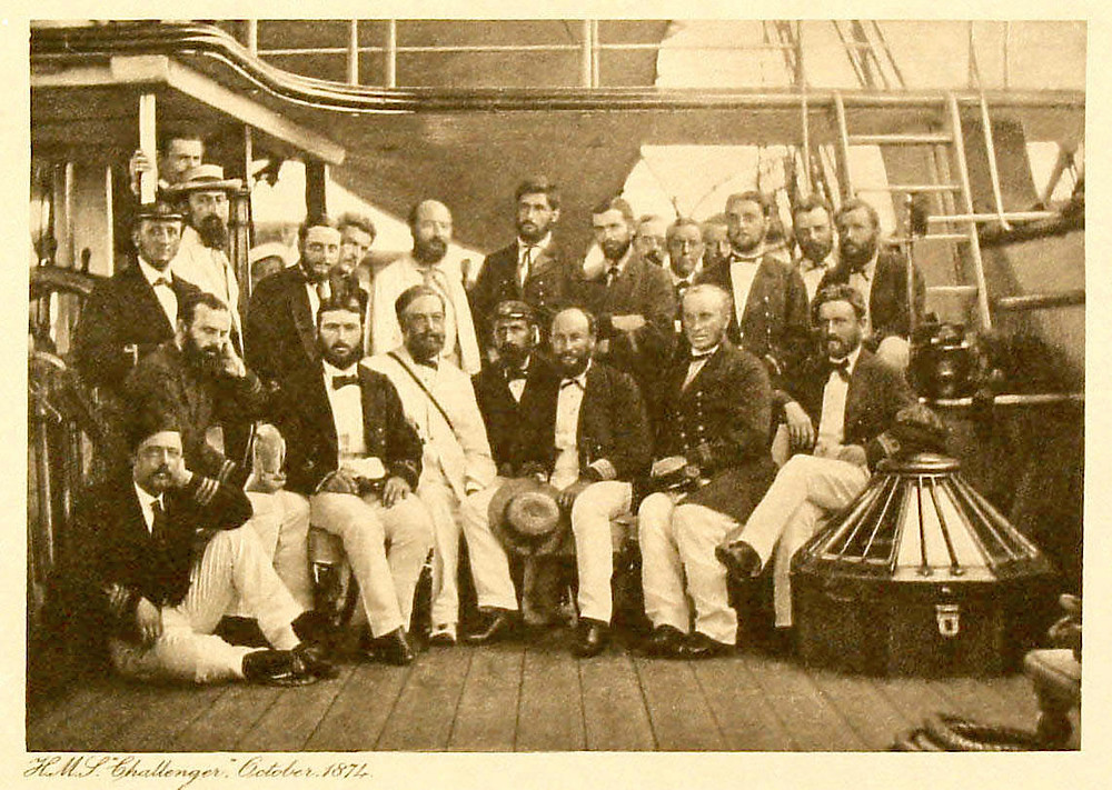 The crew of the HMS Challenger on the ship deck in 1874.
