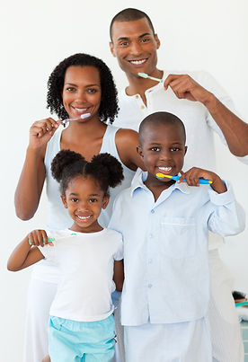 smiling family brushing their teeth.jpg