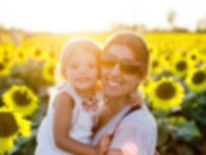 Mom and Daughter in Sunflower Field Stoc