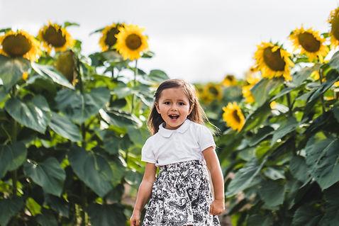pretty-girl-standing-among-sunflowers-BJ