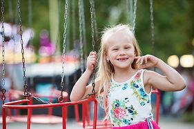 cute-little-girl-at-fun-fair-chain-swing