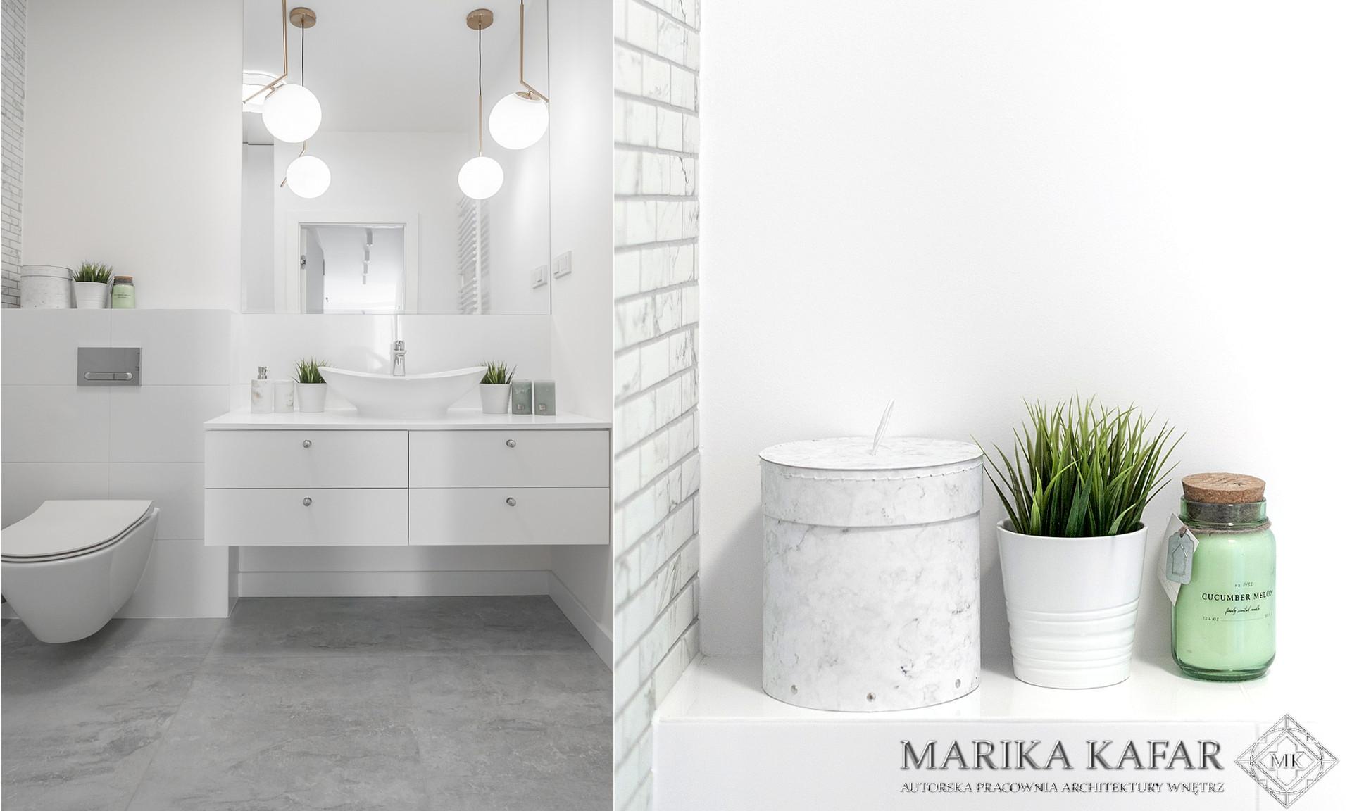 Marika Kafar. Jasna łazienka z  szarą podłogą.