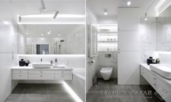 Marika Kafar. Biała łazienka z ciemną podłogą.