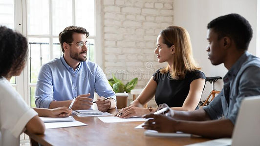 diverse-employees-listening-to-team-lead