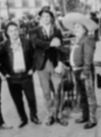 Sir Ken Potter greets a group of mariachis in Mexico City