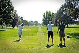 2018 9-8 golf coach hitting.jpg