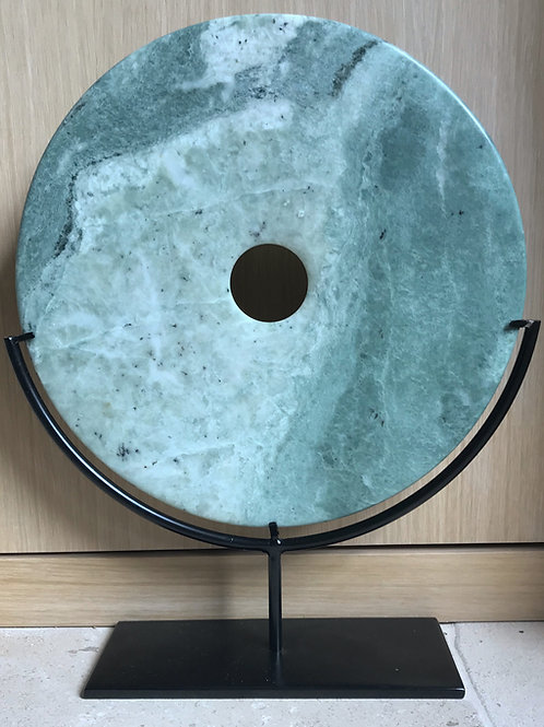 Green marble disc artifact on stand