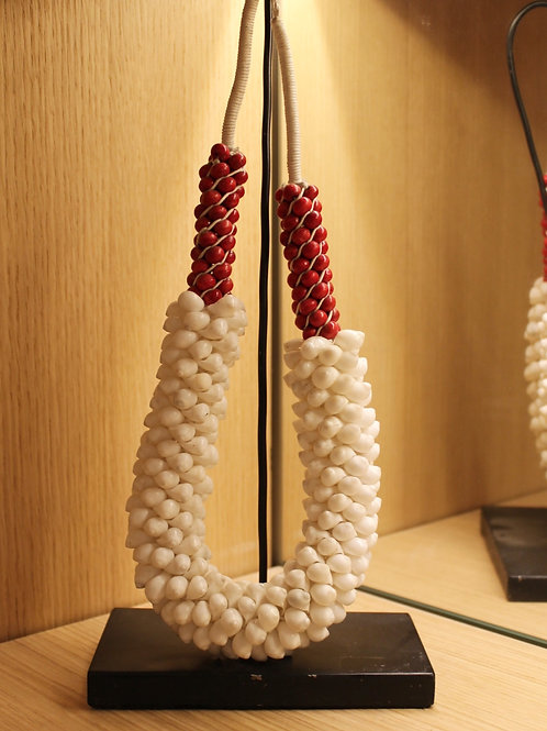 Decorative ethnic necklace on stand