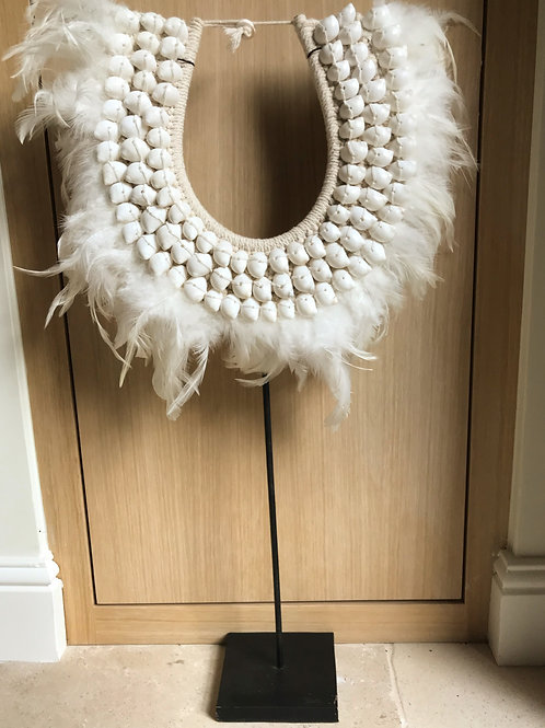 White feather ethic necklace on stand