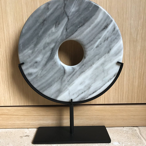 Grey marble disc on stand
