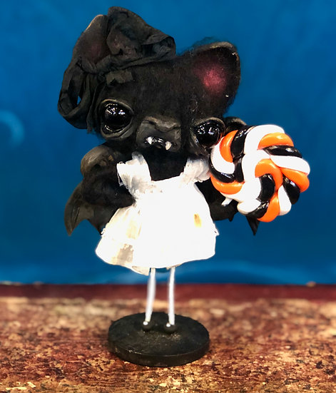 Bat Girl with Orange and Black Lolly by Kerry Schmidt