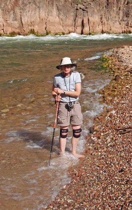 Pat cooling her tired feet in the Colorado River, Grand Canyon National Park