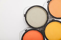 Cans of paint with warm colors inside.