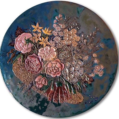 PIETRO MELANDRI Grande piatto floreale a leggero rilievo, smaltato e iridato