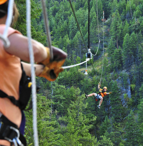 Friends ziplining across Okanagan Canyon, Peachland