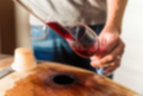 Wine_tasting_from_barrel_close_up-compre