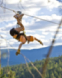 Smiling upside down lady on Okanagan zipline