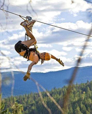 Smiling upside down lady on Okanagan zipline