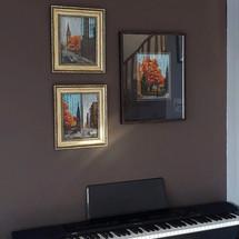 Art works on dark brown wall