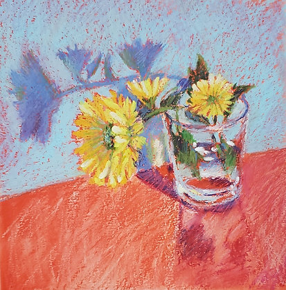 Yellow flower in a glass
